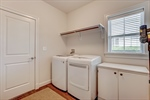 Laundry roommudroom with access to owners suite.