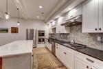 White cabinets and tile backsplash gleam!