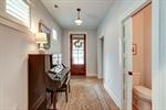 Welcoming foyer with engineered hardwood floors