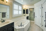 Private owners bathroom with soaking tub.