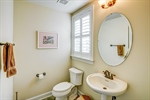 Half bathroom with pedestal sink on first floor.
