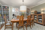 Spacious dining with custom built bookshelves