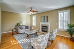 Great room with shutters and gas fireplace.