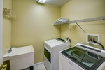 Second floor laundry room with new Whirpool WD.
