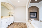 Owners bath with built in fireplace