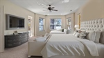 Roomy Master bedroom staged with virtual furniture