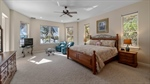 Master bedroom with French doors leading to pool a
