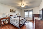 Main level owners suite with hardwood floors!