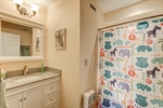 Fully renovated guest bathroom with tub