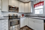 Recently renovated kitchen features white cabinets