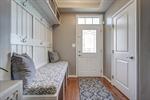 Foyer features custom-built storage bench!