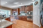 Gourmet kitchen features espresso cabinets