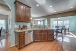 Gleaming granite and stainless appliances
