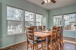 Light filled sunroom is a perfect spot for dining.