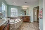 Spa-like bathroom with corner soaking tub.