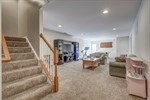Finished basement features large rec room