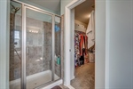 Separate shower and walk in closet.