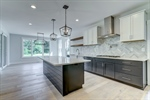 Modern kitchen with quartz counters wood cabinets