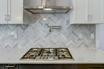 Beautiful herringbone backsplash.