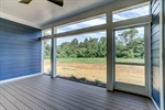 Relax on the screened porch in privacy!