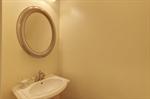 Powder room with pedestal sink.