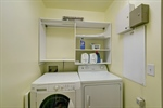 Laundry room on second floor with storage cabinets