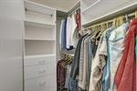 Walk in closet with built-in storage.