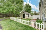 Fenced back yard with storage shed!