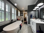 Picturesque Master Bathroom with Charming Finishes
