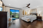 Master Bedroom - Golf course lake and  pool views.
