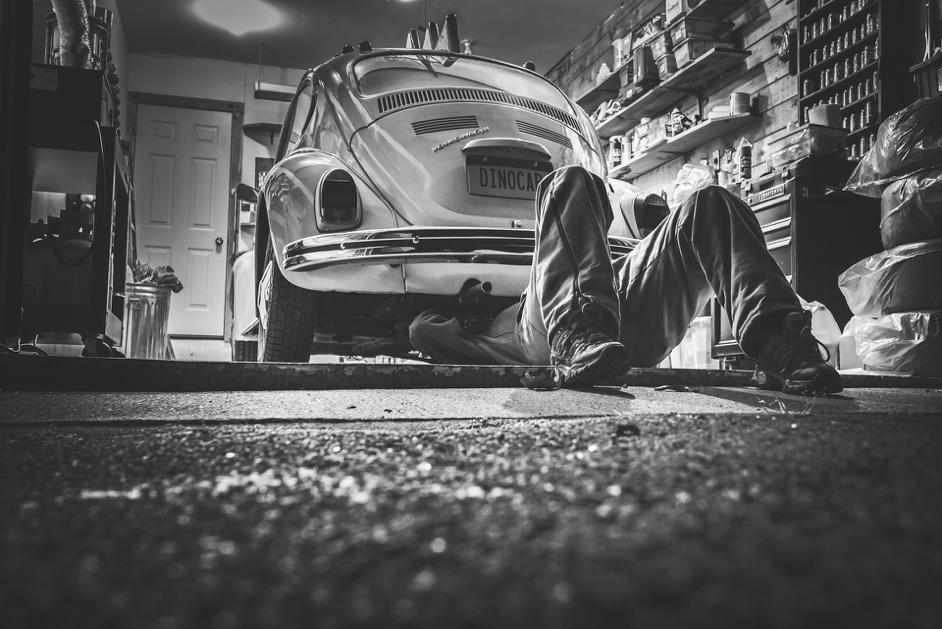 man working under VW bug. 4 Great Ways to Find the Best Mechanic