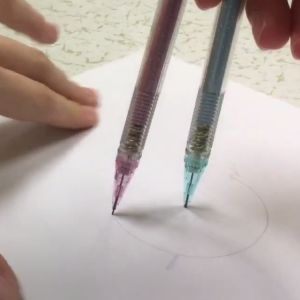 Learn to draw a circle using two pens.