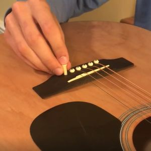 Learn how to restring a guitar.