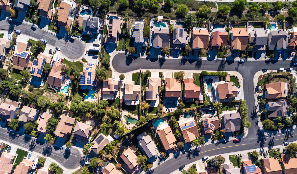Aerial shot of a neighborhood. A few of the houses have solar panels. Our photovoltaic neighbors, they are probably called. But with a hint of condescension. It appears altruism is merely an intention and not a public certainty. L'enfer, c'est les autres.