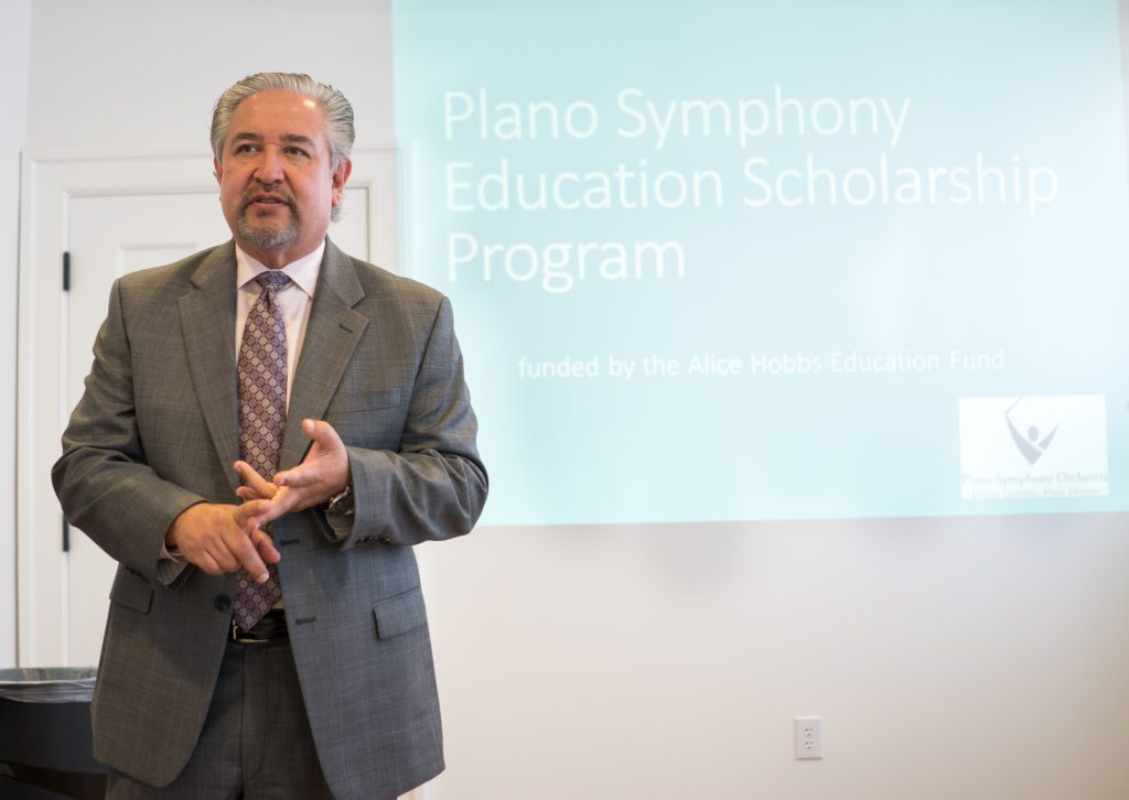 Maestro Hector Guzman tells the crowd at the press release how scholarships helped him throughout his music education.