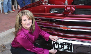 Heather Perry holds the new plates to her father's restored 1967 Chevy C10, frisco, downtown plano