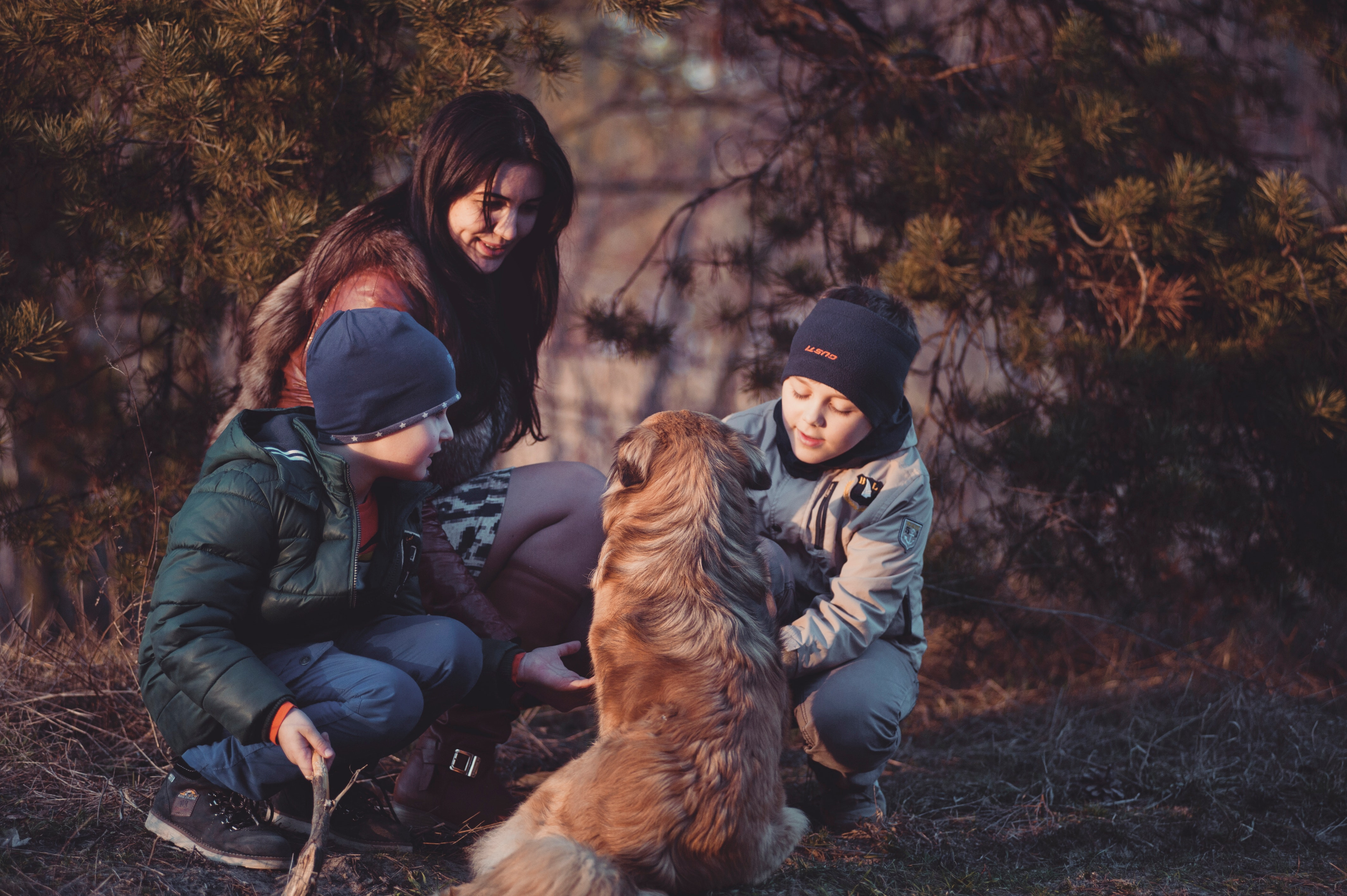boy children with mother and golden dog