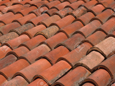 Spanish Tile Roofs Are Effective In Areas With Heavy Rain. The Tiles Are  Shaped Like A Series Of Waves That Have Wide Spaces In Between For The  Water To ...