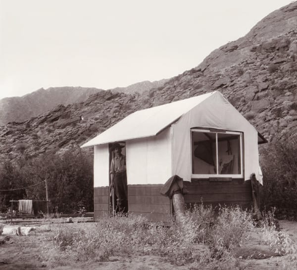 Carl Eytel in his cabin, Palm Springs, California, undated.