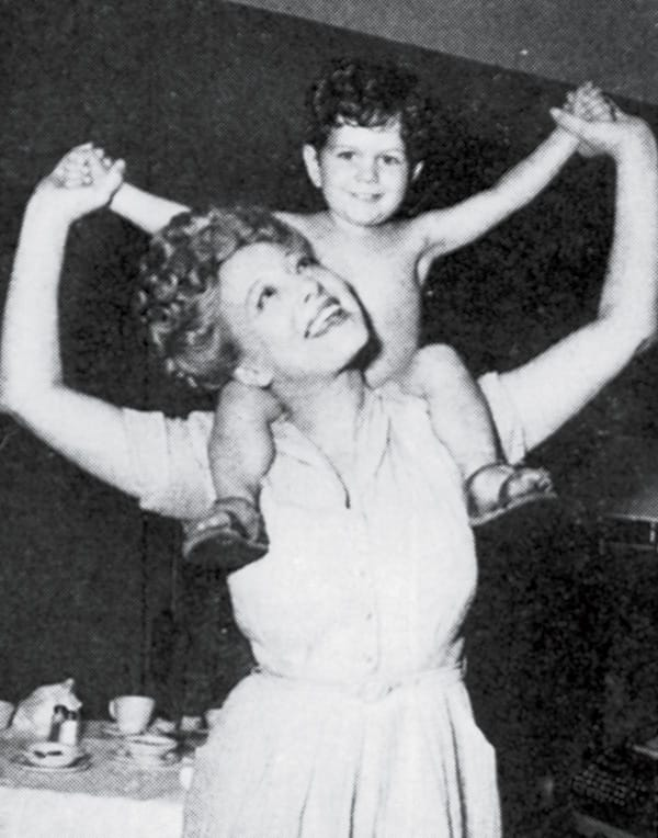 Sally Rand headlined her own star-studded revue in the Chi Chi's Starlite Room. Pictured with her is Sean Orion Rand.