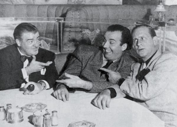 Lou Costello (right) and Bud Abbott (left) with Arthur Blake.