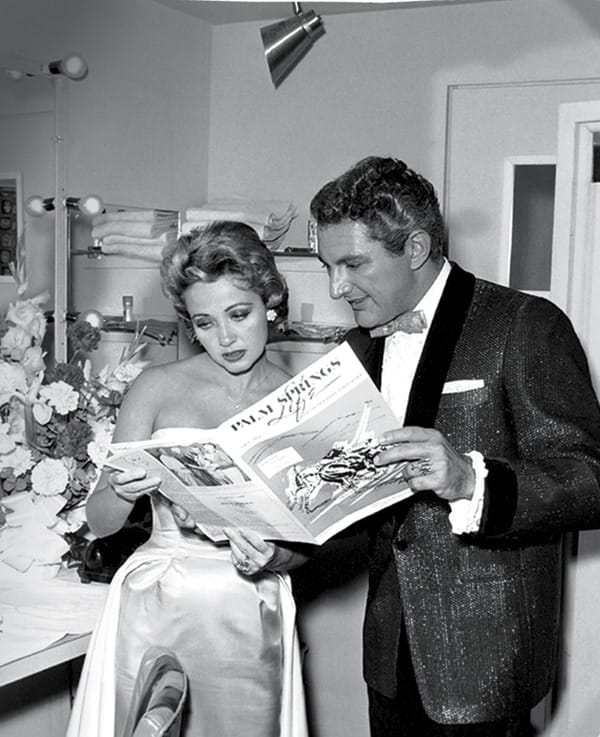 Jane Powell and Liberace read Palm Springs Life in their dressing room.