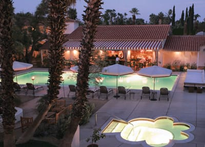 The courtyard pool and spa lie at the heart of the Colony Palms, with guest rooms on one side and the Purple Palm Restaurant & Bar on the other. The jacuzzi is an unusual cloverleaf shape.