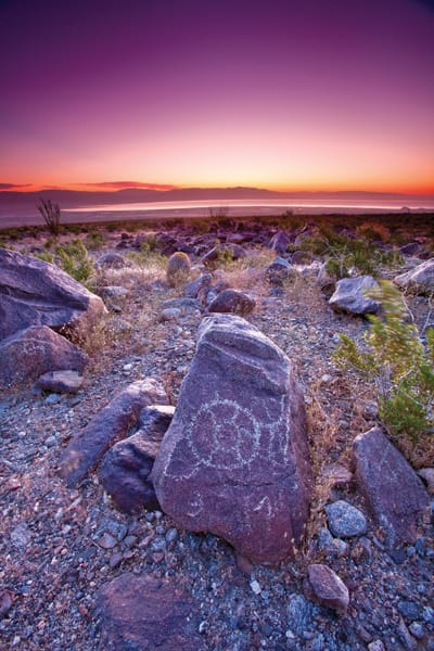 "As Brewster watched the sunrise over the Salton Sea, he says, ""It was obvious to us we have a sun symbol [on the petroglyph] because this rock lines up perfectly with the sun in the east."" Archaeologist Harry Quinn advises to note natural features (springs, trails) petroglyphs face for clues to their intent."
