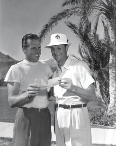 Baseball player and Thunderbird charter member Ralph Kiner shares a prize-giving moment with Fred Haas Jr. at the 1954 tournament.