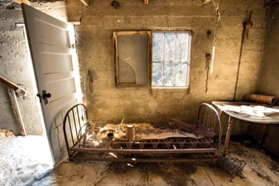 Sand had blown into Jack Miller's cabin over the years and wedged the door open. The table holds a registry for the occasional hiker.