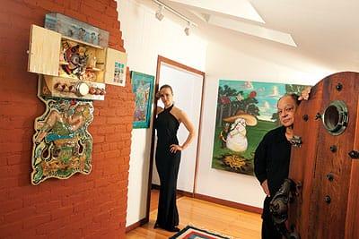 "Cheech and Natasha Marin appear with ""El Astronauta"" (2003), a 46x23x8-inch mixed-media work by Einar and Jamex de la Torre and, on the back wall, ""La Noche Buena"" (2007), a 54x60-inch oil on canvas by Ricardo Ruiz."
