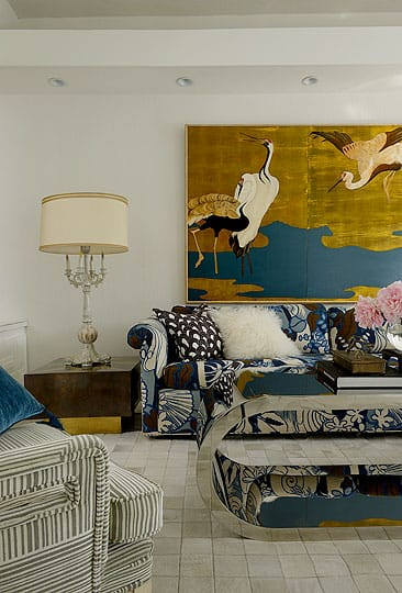 """I tend to gravitate toward vintage,"" says Gaston. ""But art is emotional. You either love it or you don't. If I have an emotional reaction to a piece, it doesn't matter if it was created in 1957 or 2011."" Here, the living room's décor blends a chinoiserie screen and a baroque lamp with a sofa upholstered in vintage fabric and a 1970s chrome table. The throw pillows are covered in Trina Turk fabric, and the throw rug is a quilt of cowhide. The result is an eclectic yet harmonious living space."
