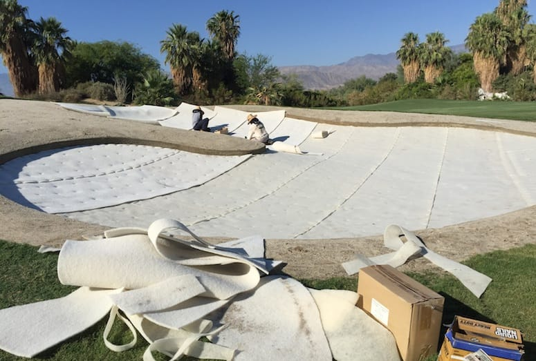 Workers add new liners to a sand trap at Desert Willow Golf Resort's Firecliff Course