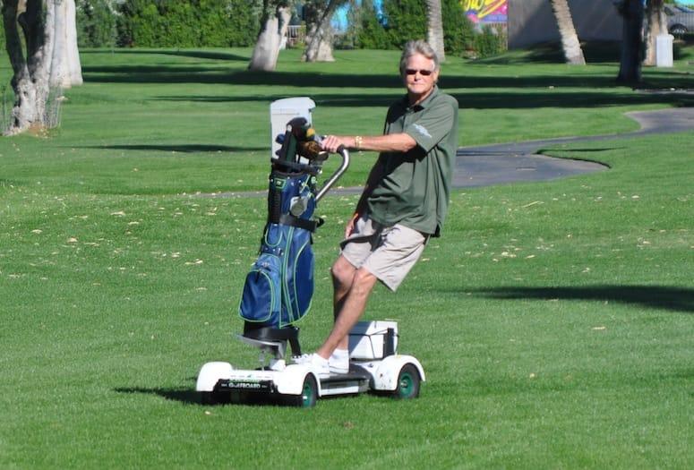 Tim Venturi riding a golfboard